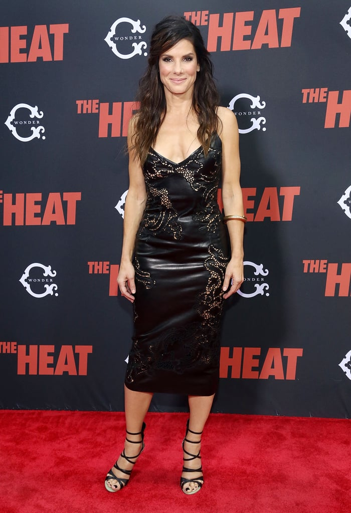 Sandra Bullock wore a skintight leather dress to premiere The Heat in NYC.