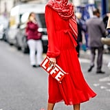 Wear a Printed Red Scarf With a Matching Dress and Feathered Heels
