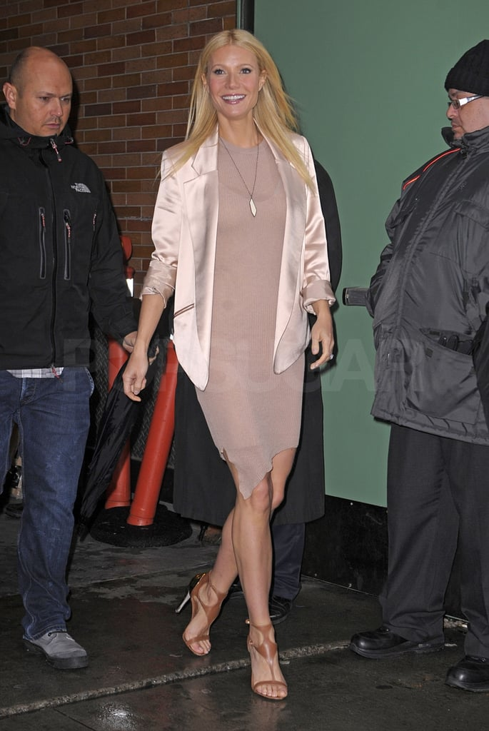 "Gwyneth Paltrow stepped out into the NYC rain after an appearance on Good Morning America today. She's making the press rounds to promote her cookbook, My Father's Daughter, which she launched with a star-studded party earlier this week. She got dressed up again to support pals like Christy Turlington Burns and Meryl Streep at last night's Good Housekeeping Shine On Awards. Gwyneth's also gearing up for her second cameo on Glee after debuting her ""Somewhere Over the Rainbow"" duet with Matthew Morrison on Monday. She'll reprise her role on the small-screen hit in next week's new episode, but you don't have to wait until then to see Gwyneth get back to singing. She also shows off her musical skills in the Country Strong DVD that was released today."