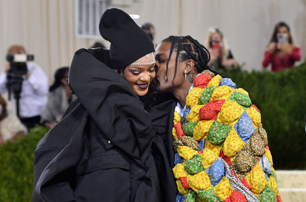 Everyone knows Rihanna is the queen of the Met Gala, and this year, she had her king by her side. On Monday night, the singer attended the star-studded event with boyfriend A$AP Rocky. Though this wasn't their first time walking the red carpet together, it did mark their very first Meta Gala since confirming their romance in May. For the special occasion, the two looked cozier than ever — literally — as they wrapped up in oversize parkas. Although, it wasn't their stunning outfits that captured our attention, it was their sweet PDA. The two couldn't contain their smiles as they held hands and stared lovingly into each other's eyes, and A$AP Rocky eventually leaned in for a sweet kiss. See more pictures from their adorable Met Gala appearance ahead.       Related:                                                                                                           Rihanna and A$AP Rocky Have Love on the Brain, and These Photos Prove It