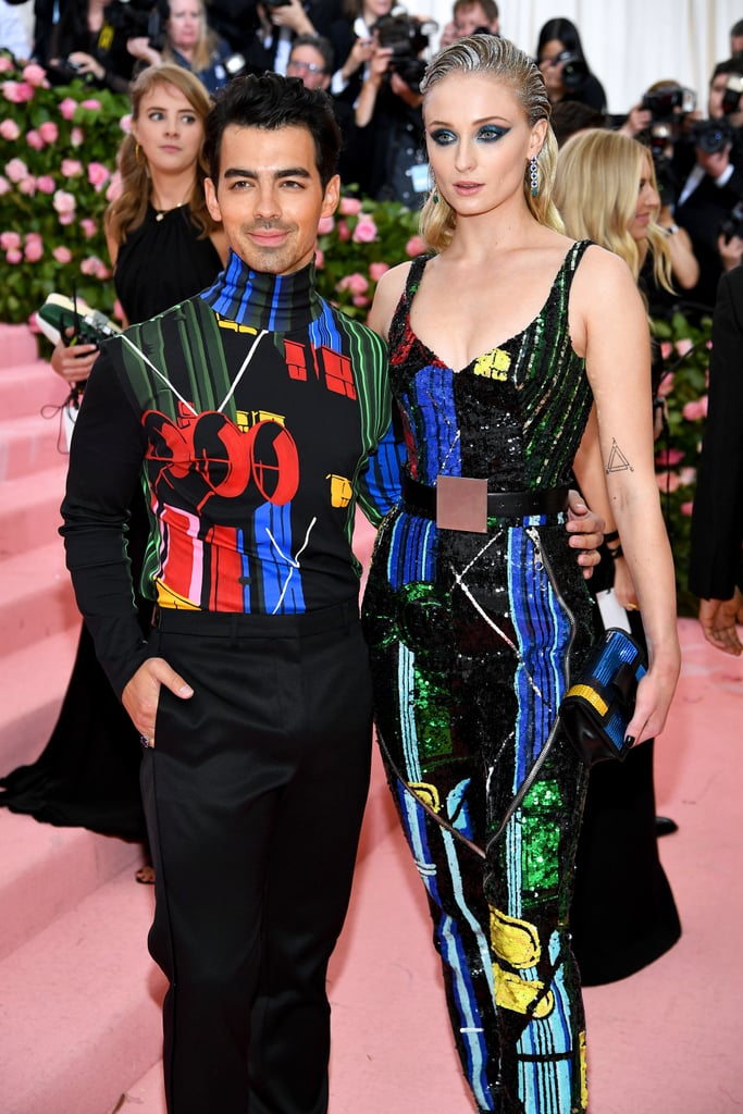 Mr. and Mrs. Jonas are in the building! Sophie Turner and Joe Jonas made their first red carpet appearance as husband and wife at the 2019 Met Gala, and it did not disappoint. Wearing matching outfits and a newlywed glow, the couple couldn't keep their hands off each other while posing for photos.  It's been quite the week for Sophie and Joe, who tied the knot in Las Vegas after the Billboard Music Awards last week. Now, for their public debut as Mr. and Mrs., their love is shining brighter than Sophie's highlighter. Check out the gorgeous photos of Sophie and Joe at the 2019 Met Gala ahead, and give it up for the hot couple.      Related:                                                                                                           Priyanka Chopra Gave Us Major Alice in Wonderland Vibes on the Met Gala Carpet