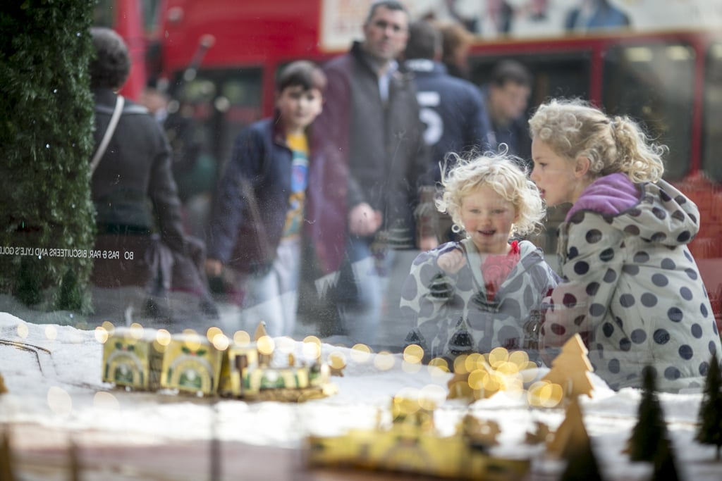 Children enjoyed the window displays in London, England.
