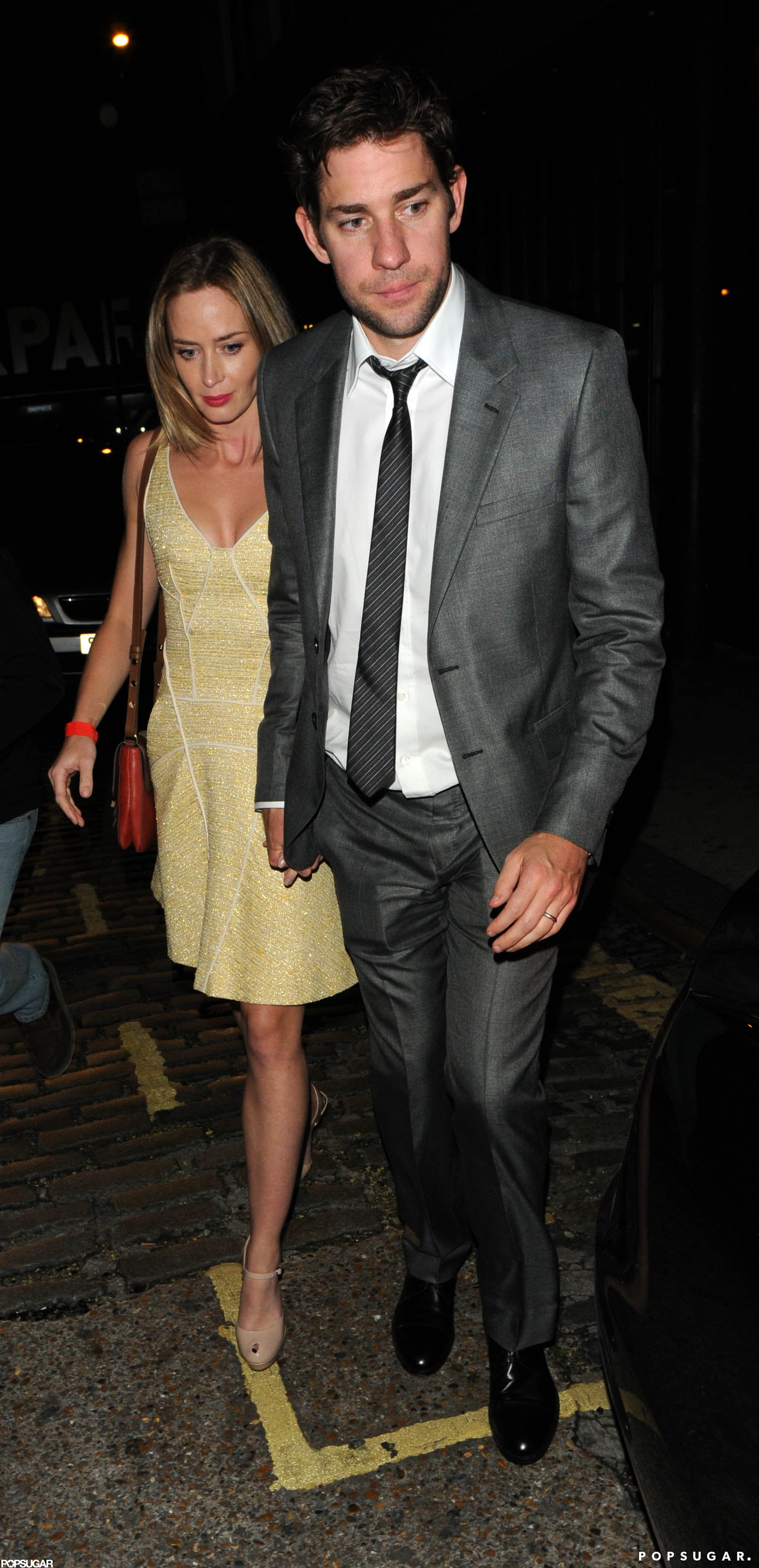 Emily Blunt and John Krasinski arrived hand in hand to Stanley Tucci and Felicity Blunt's wedding in London in October 2012.