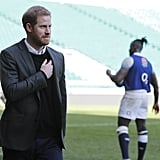 For a day spent with the England rugby team, Harry opted for a black sweater, which he wore underneath a smart blazer.
