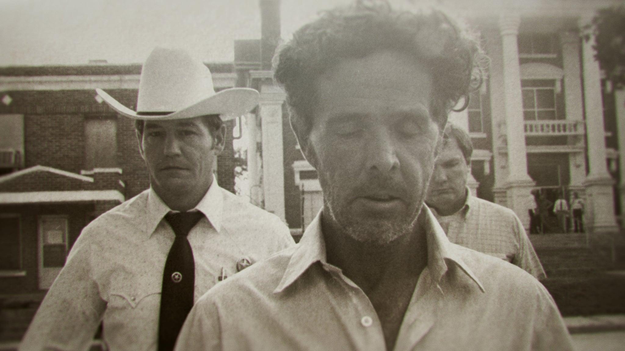 The Confession Killer — Henry Lee Lucas (center) walking in front of Ranger Phil Ryan (left)