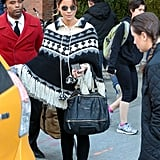 She kept warm in a printed poncho and accessorized with the Givenchy Pandora bag.