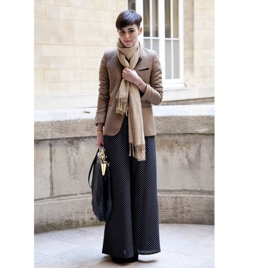 """In March 2011, printed bottoms began being snapped on the street. Here, Anne-Catherine Frey wears a dotted palazzo pant at Paris Fashion Week.  Shop similar styles:  <iframe width=""""286"""" scrolling=""""no"""" height=""""244"""" frameborder=""""0"""" src=""""http://widget.shopstyle.com/widget?pid=uid5121-1693761-41&look=3500516&width=3&height=3&layouttype=0&border=0&footer=0""""></iframe>"""