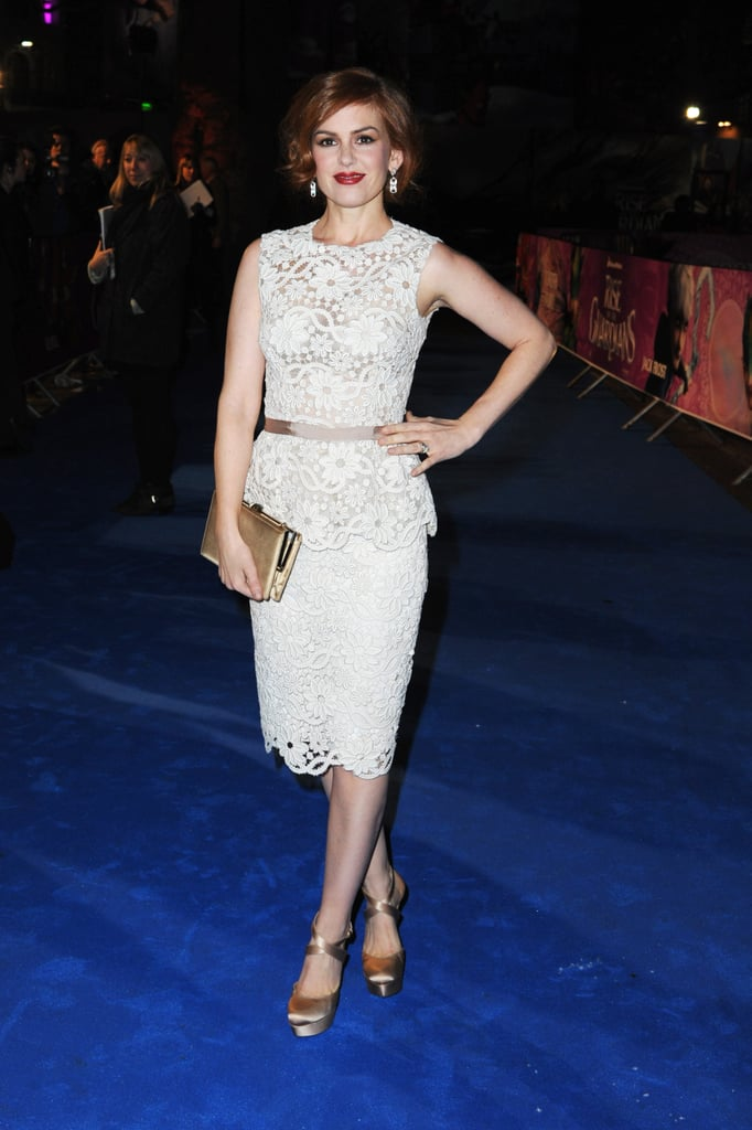 Isla Fisher turned up the ladylike polish in a white lace peplum dress by Oscar de la Renta at the UK premiere of The Rise of the Guardians.