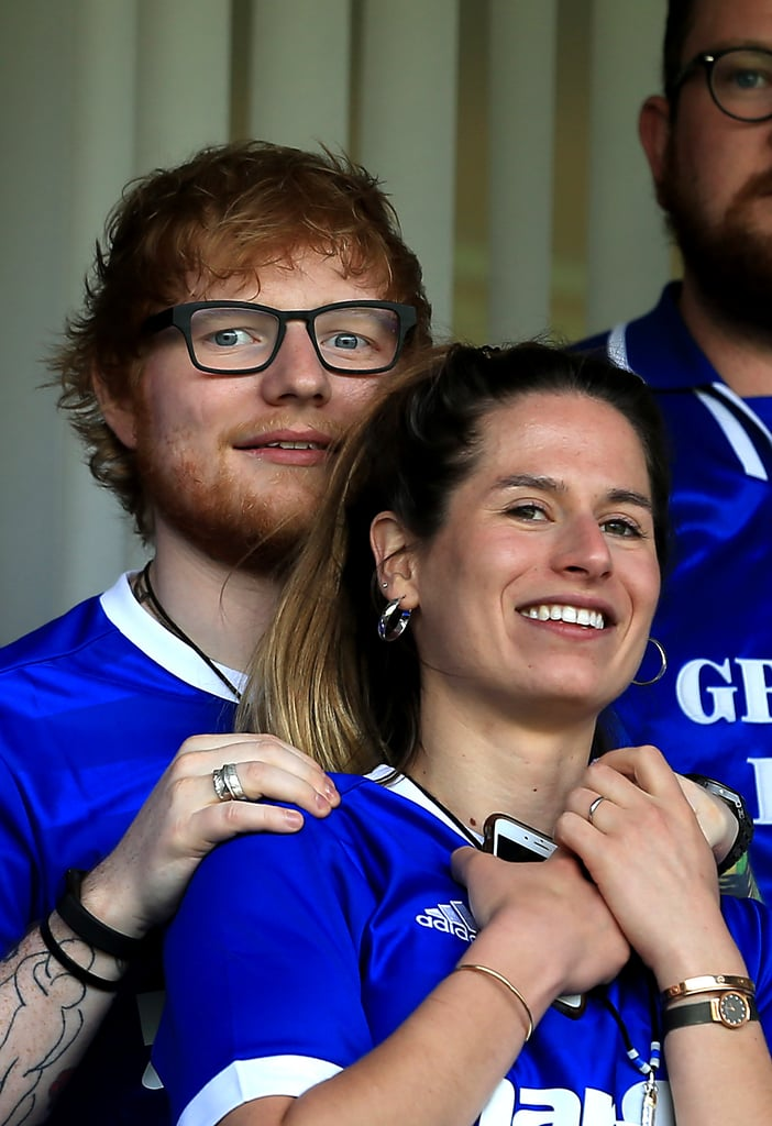 Ed Sheeran and Cherry Seaborn were two peas in a pod at the Sky Bet Championship match in England on Saturday. The adorable couple, who announced their engagement in January, looked on as Ipswich Town faced off against Aston Villa. (Aston Villa won the match 4-0.) In February, rumours began swirling that Ed and Cherry had already tied the knot, but the reports were false. Ed and Cherry, who began dating in September 2015, have yet to set a date to walk down the aisle. Keep reading to see more photos of Ed holding his fiancée close and flashing a smile. These two really have the look of love down, don't they?       Related:                                                                                                           6 Times Ed Sheeran's Comments About Cherry Seaborn Were Cute Enough to Be Lyrics