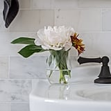 A bud vase on the sink kicks the glam factor up a notch.  Photo by Samantha Goh via Homepolish