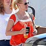 January Jones in a red shirt after giving birth.