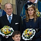Philip and Princess Beatrice held on to flower bouquets after church service in April 2012.