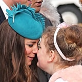 She was greeted with a traditional hongi — the Maori custom of pressing one's nose and forehead to another person — by a young girl as she arrived in New Zealand in April 2014.