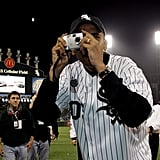 Snapping a picture at a White Sox game as a newly elected senator in 2005