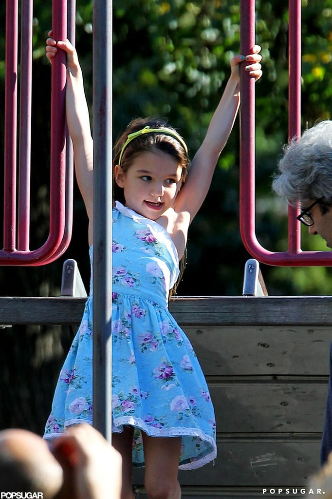 Suri Cruise climbed around a playground in Brooklyn.