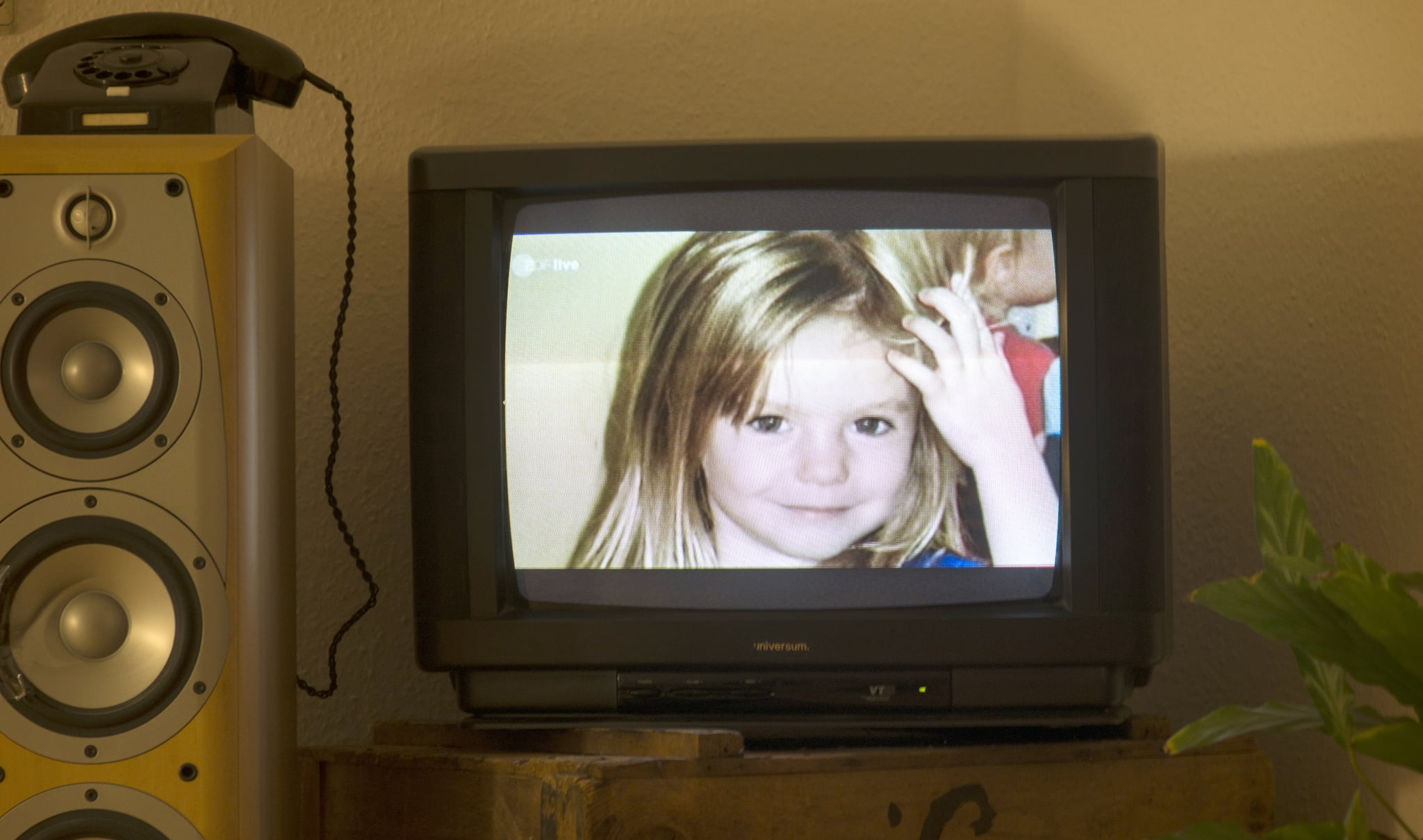 A photo of British girl Madeleine McCann aka Maddie is displayed on a TV screen at an appartmen in Berlin, on October 16, 2013 during the broadcast of German ZDF's