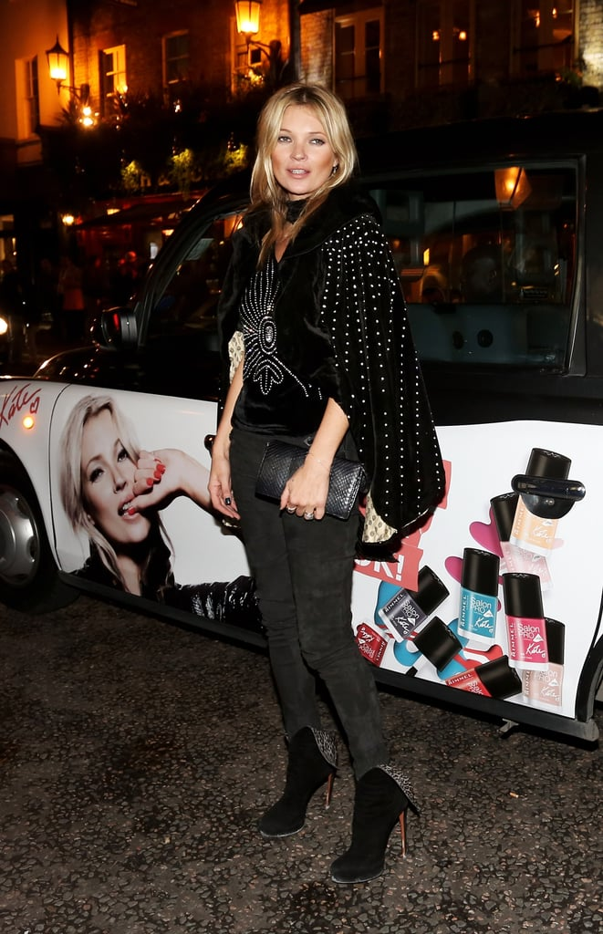 Kate Moss posed in front of a car with her photo.