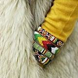 Eclectic bracelets brighten up a furry layer.  Source: Tim Regas
