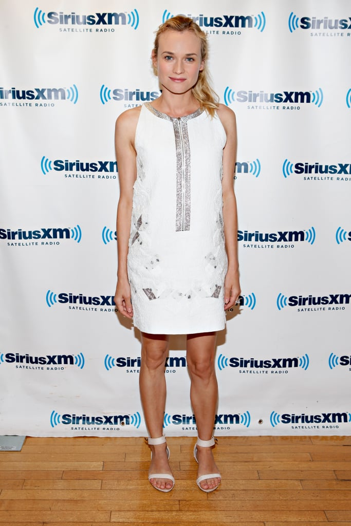 """Diane Kruger looked fresh in a white Vanessa Bruno dress when she stopped by the Sirius XM studios in NYC on Tuesday. The actress is making the press rounds for her latest film Farewell, My Queen, which she premiered on Monday in a form-fitting Azzedine Alaïa gown. At the screening, Diane's boyfriend Joshua Jackson gushed about seeing his real-life leading lady dressed up in character as Marie Antoinette in the movie. He said, """"I definitely made the effort to go see her in the full queen regalia. It's a one-time thing in an actor's life. It was sexy — period, full stop. I mean, it was kind of a kinky fetish thing with the wigs and the corsets. I don't know how [people] survived that period. Foreplay must've been a sonofab*tch. It takes a nation of millions to get those things on and off."""" The celebrity couple also attended an event at the Whitney Museum to celebrate the launch of Louis Vuitton's collaboration with Yayoi Kusama on Tuesday night."""