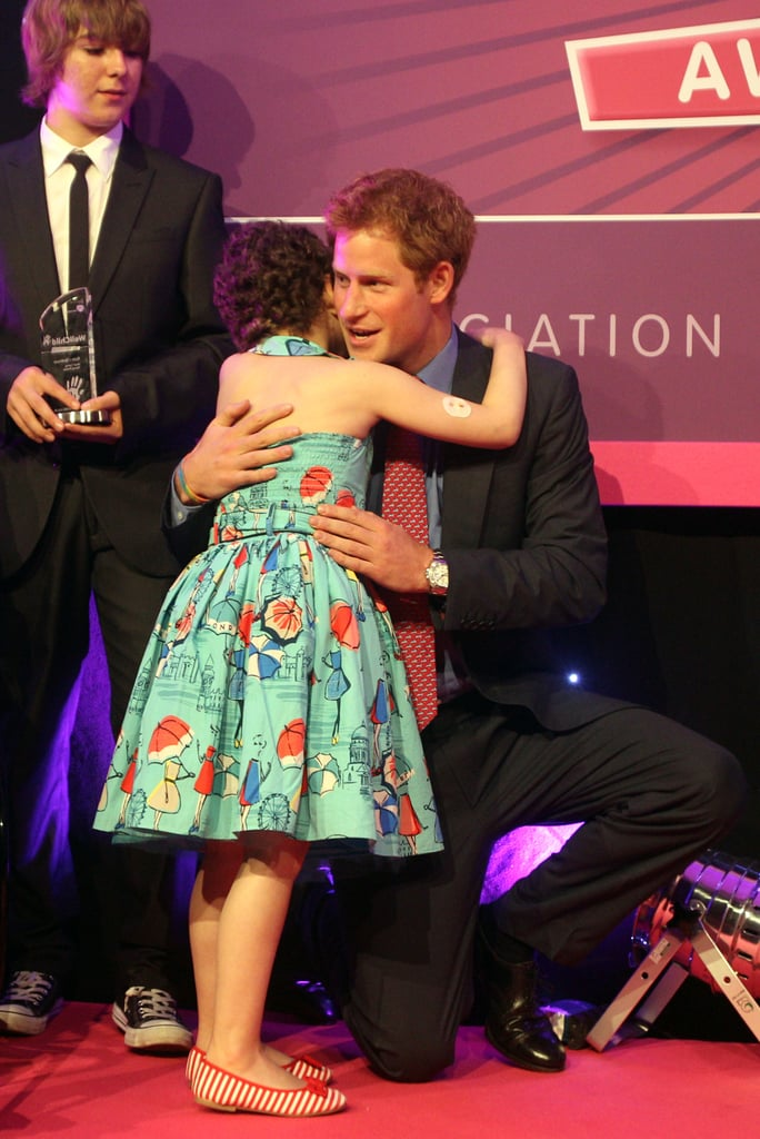 Prince Harry resumed his public work this evening at the WellChild Awards in London. He was decked out in a suit on his way into the city's InterContinental Hotel, where the gala for the organization was being held. WellChild, a charity of which Harry is an official patron, raises funds to help sick children. Harry has been lying low recently since pictures emerged of him naked partying in Las Vegas. After the images were initially released, the palace dealt with further drama when one woman, who alleged she kissed Harry during the clothing-optional party, sold her story to UK newspaper The People. She claimed that Harry was encouraging everyone to strip down, and after playing air guitar on a pool cue, he asked for someone to get him a glove as a prop for his Michael Jackson impression.