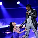 Usher crooned to a back up dancer.