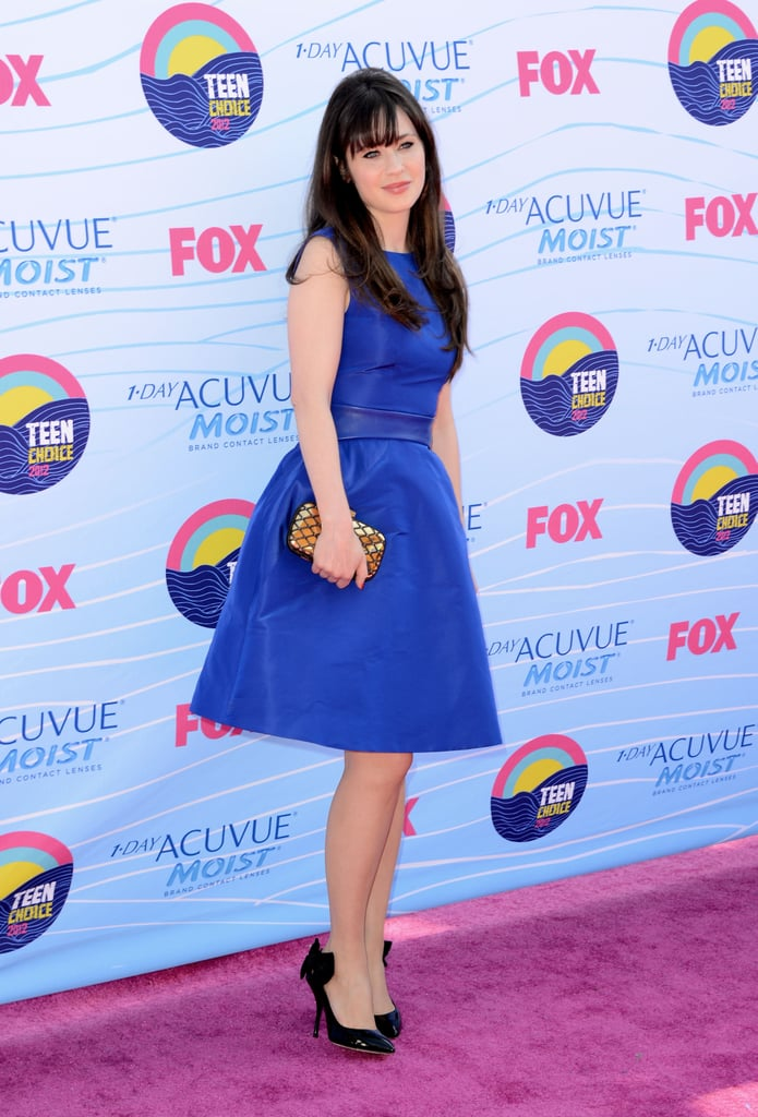 """Zooey Deschanel made her way into the Teen Choice Awards in a blue dress by Monique Lhuillier today. The New Girl actress is up for two big honours today: choice TV actress in a comedy and choice female fashion icon. Zooey also hit the TCAs stage to present with birthday girl Selena Gomez, who she described on Twitter as """"beautiful and charming."""" Weigh in on Zooey's look by voting on Fab and Bella's polls."""