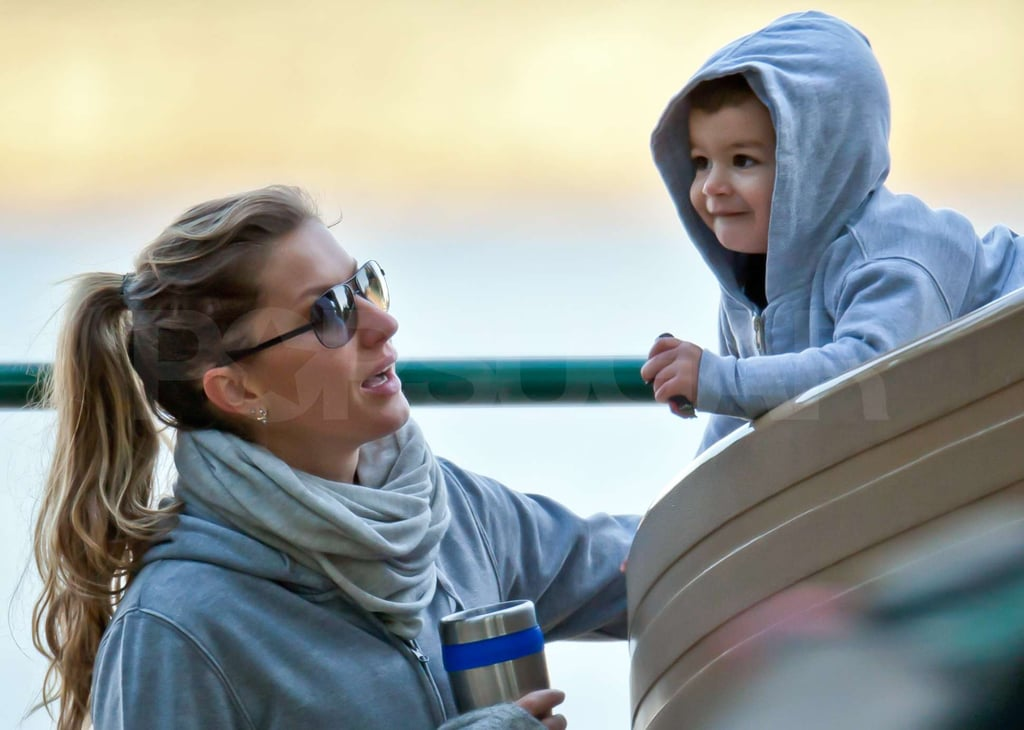 Gisele Bundchen juggled her coffee and a camera as she unwound with her toddler Benjamin Brady at a Boston park today. The mother and son played on the slide in matching sweatshirts, and Gisele also snapped some photos of Benjamin as they enjoyed the morning playdate. The supermodel is back home with Benjamin and Tom Brady following her stint at Paris Fashion Week over the weekend. Gisele walked in the Givenchy Spring 2012 show and joined celebs like Kanye West, Liv Tyler, and Jennifer Hudson at the luxury brand's afterparty. Once the stylish celebrations were over, she headed back to Massachusetts, where she returned to her workout routine yesterday at the gym. Tom has been focusing on his own athletics as the Patriots kick off football season. The team played the Raiders in Oakland last week, winning 31-19, in their second game of the season.