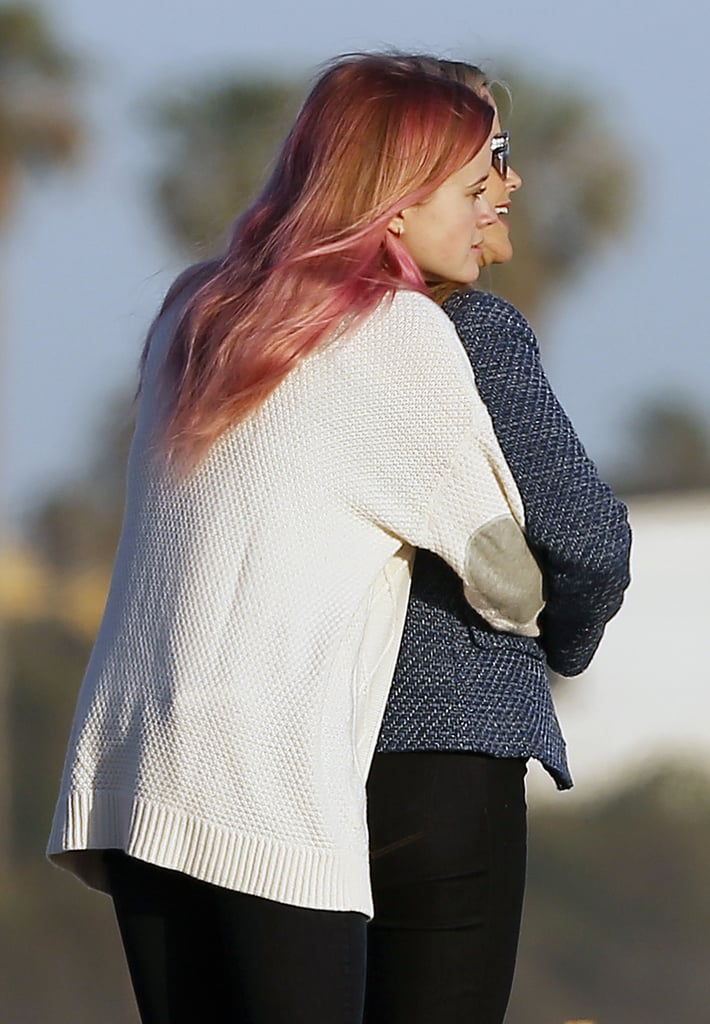 """Reese Witherspoon and her 16-year-old daughter, Ava Phillippe, shared a sweet moment while at the beach in Malibu, CA, on Wednesday. While looking out on the ocean together, Ava wrapped her arms around her mom and gave her a warm hug from behind. Also on hand for the outing were Reese's sons and Ava's brothers, Deacon and Tenneesee, who also looked to be enjoying the sun and sand. Reese shared a photo of the gorgeous sunset on Instagram, writing, """"Does it get any better than this? #GoldenHour.""""  Even though it's only March, Reese has already logged some quality beach time; earlier this month, right after attending the Oscars, she jetted off to Mexico with a group of girlfriends. She also got some sun during a Goop luncheon in honor of her pal Gwyneth Paltrow last week, which also brought out Drew Barrymore, Nicole Richie, and Cameron Diaz. Keep reading to see Reese and Ava's beach bonding moment, then see more of Reese's cutest family photos."""