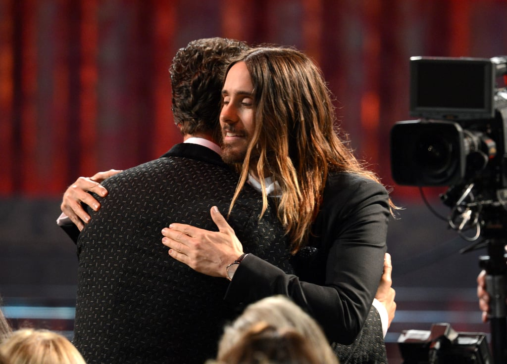 Jared Leto gave his Dallas Buyers Club costar Matthew McConaughey a pat on the back at the SAG Awards in January 2014.