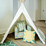 A playful tent and kid-size armchair make the living room feel anything but stuffy.