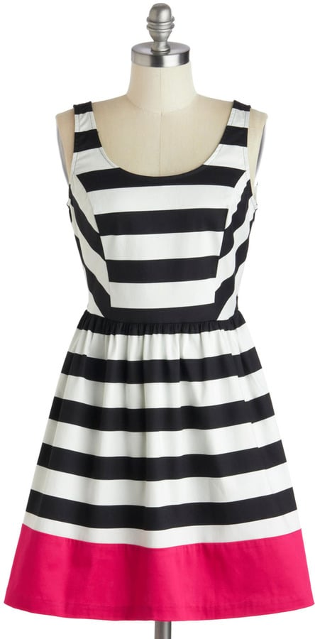 Mix up your trends! We love the bold look of this ModCloth black and white striping ($48) contained by a thick stripe of bold pink.
