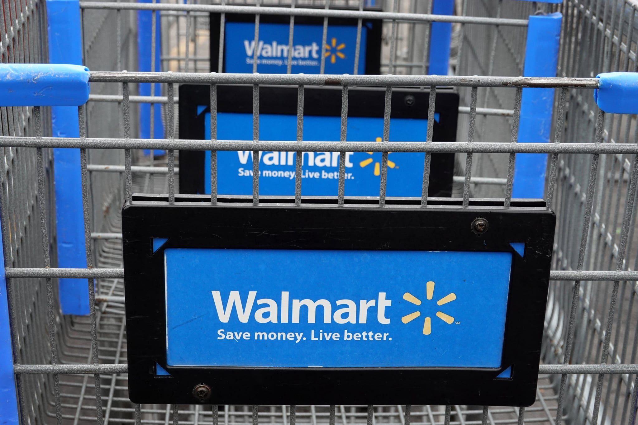CHICAGO, ILLINOIS - MAY 19: Shopping carts sit in the parking lot of a Walmart store on May 19, 2020 in Chicago, Illinois. Walmart reported a 74% increase in U.S. online sales for the quarter that ended April 30, and a 10% increase in same store sales for the same period as the effects of the coronavirus helped to boost sales. (Photo by Scott Olson/Getty Images)