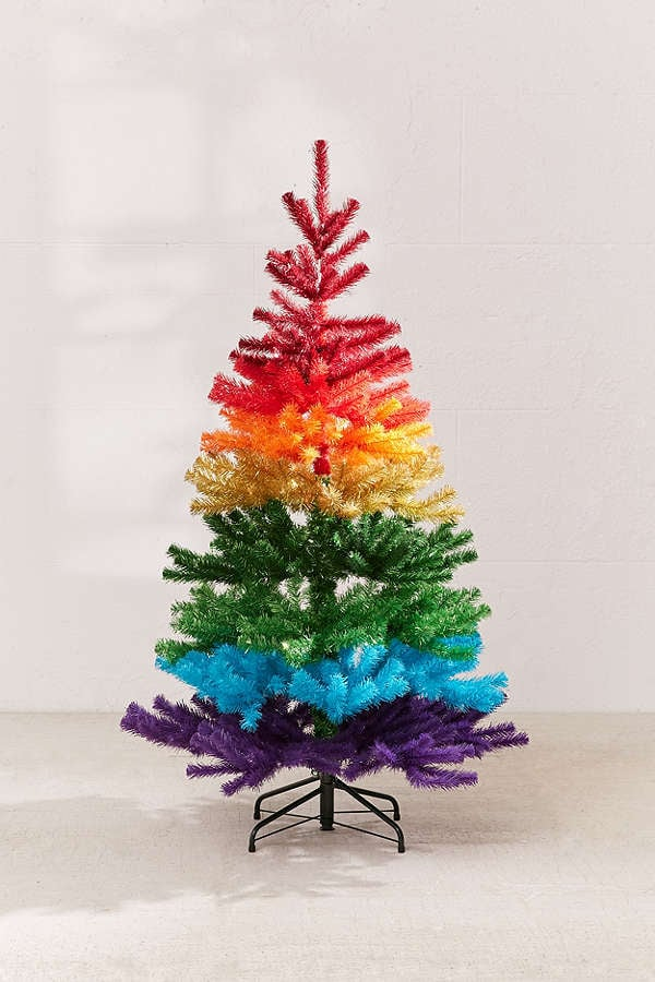 bring the debate over whether to get a real or artificial christmas tree to a halt by throwing this ombr rainbow tree into the mix no its not real