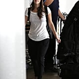 Known for her mastery of the cool-girl classics, Rachel Bilson continues her reign with a gray knit beanie, the most perfect worn-in white tee, and cool taupe booties.