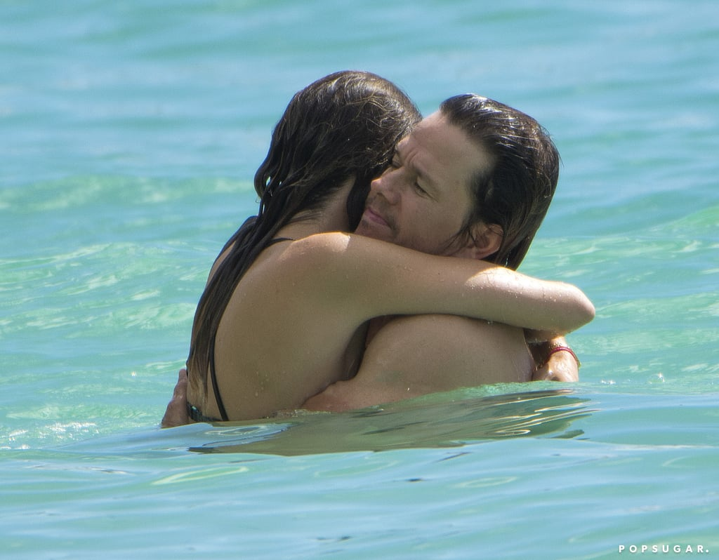 """Mark Wahlberg plays a hero in his two latest movies, Patriots Day and Deepwater Horizon, but on Sunday, he was just a regular guy splashing around the beach in Barbados. The actor, who was sporting his trademark farmer's tan, appeared to be enjoying the day with friends, and on Monday, he returned to the beach with his wife, Rhea. The duo splashed around in the ocean before retreating to their lounge chairs and basking in the sun. Between his nonstop film roles, his stint as producer on the hit HBO show Ballers, and his hilarious habit of embarrassing his daughter, no wonder the incredibly busy Hollywood heavyweight needed to kick back with a tropical vacation. Luckily, his method of relaxation includes showing off his abs and biceps, which has us more convinced than ever that he hasn't aged since his Marky Mark days.       Related:                                                                Yep, Mark Wahlberg Talks About His """"Hairy Ass"""" on Ellen                                                                   Mark Wahlberg and Will Ferrell Joke About Their Intense Soccer Dad Moments                                                                   Mark Wahlberg and His Wife Embarrass Their Daughter by Making Out For All to See"""