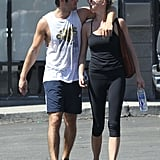 Emily VanCamp and Josh Bowman walked close together as they left the gym.