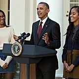 The girls couldn't help but smile over their dad's jokes at the annual turkey pardoning ceremony in November 2015.