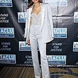 Zendaya's gray Kayat high-waisted trousers were complete with a complementing blazer that featured silver lapels, along with a satin tank.