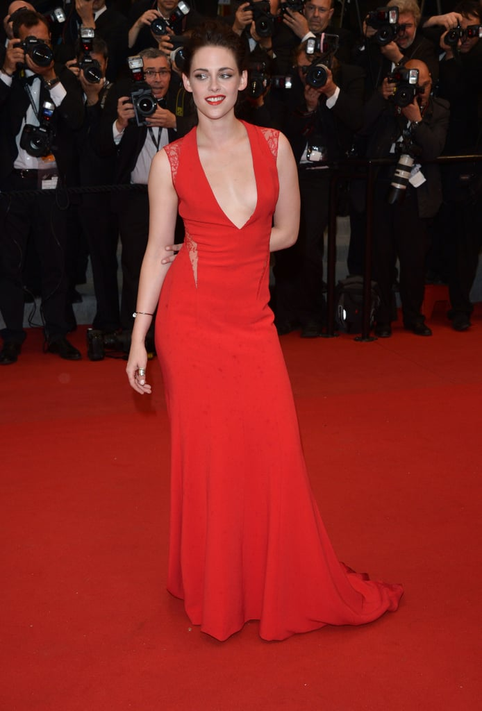 Kristen looked red-hot in a fitted Reem Acra gown with a deep V neckline at the Cannes Film Festival premiere of Cosmopolis in late May.