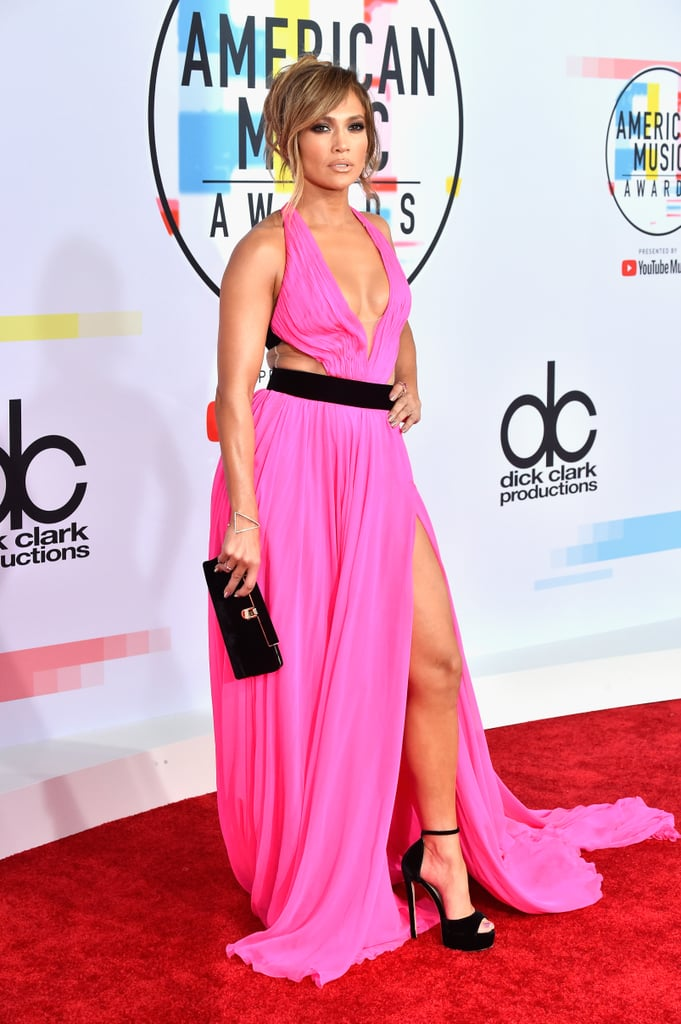 "Jennifer Lopez can do no wrong! On Tuesday, the singer looked all kinds of sexy when she arrived for her big night at the American Music Awards in LA. Clad in a hot-pink cutout dress, Jennifer was glowing as she strutted down the red carpet. Jennifer may have celebrated her 49th birthday earlier this Summer, but you'd never know it by just looking at her. Jennifer will be debuting a new song from her upcoming film, Second Act, later tonight. ""🚨 BIG NEWS!! 🚨 Performing my new single from #SecondAct on the @AMAs THIS TUESDAY! TUNE-IN!,"" she tweeted. ""It's gonna be an AMAZING night."" Second Act is a romantic comedy starring Milo Ventimiglia and Vanessa Hudgens and is set to hit theaters on Dec. 14."