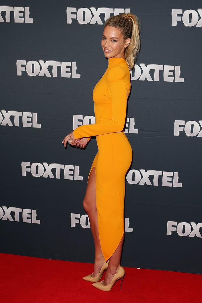 This form-fitting marigold gown fit Jen like a glove at the 2013 Foxtel Launch at Fox Studios.