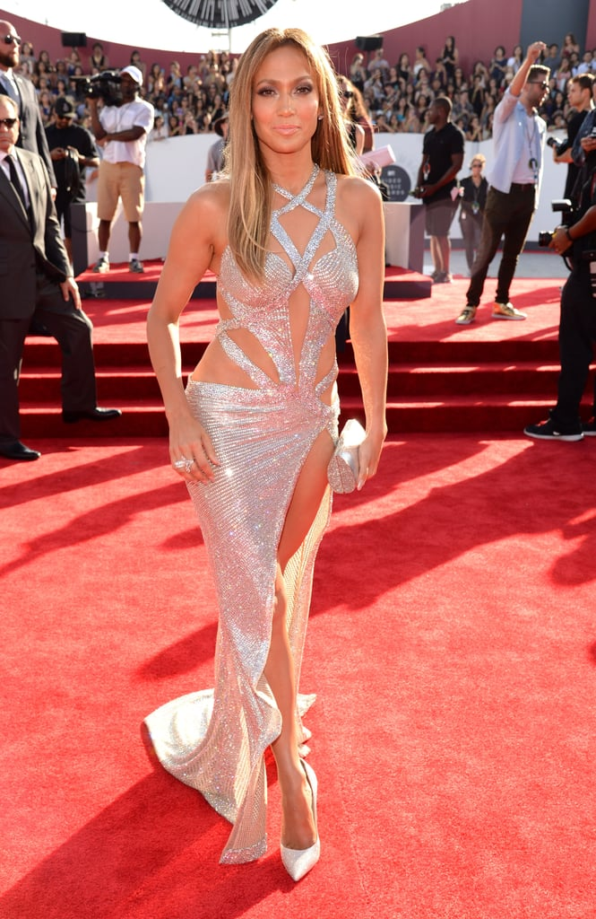 "Jennifer Lopez has been attending the MTV VMAs since 1998 (yep, that's exactly 20 years ago), but her appearance this year might just be her biggest. Not only is her hit ""Dinero"" featuring Cardi B nominated for best collaboration and best Latin video, but Jennifer is the guest of honor, as she's set to receive the coveted Michael Jackson Video Vanguard Award. In honor of Jennifer's massive achievement, we're taking a walk down memory lane and looking back at her best MTV VMAs moments through the years. Congrats, Jennifer! Related: 20 Times Jennifer Lopez Flaunted Her Sexy Body in a Bikini"