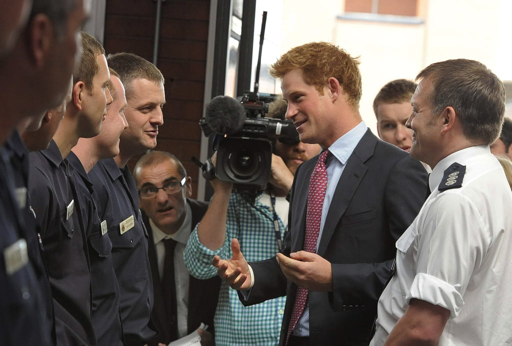 """Prince Harry paid a visit to the Pendleton Police Station this morning in Salford, near the English city of Manchester. He spoke with officers, firefighters, and ambulance crews about the recent riots that affected their town, as well as cities across England. Harry met with emergency responders after his father, Prince Charles, and stepmother, Camilla, made similar stops yesterday, talking with residents of the London suburb Croydon who were affected by the looting. Harry had nothing but praise for the men and women, saying, """"As an army officer I really respect the work you guys do, and I can't praise your bravery high enough."""" Harry's military work will soon necessitate that he leave the UK. Prince Harry will go to the US, according to recent reports, for training in the deserts of California and Arizona, then may be deployed for a second tour in Afghanistan."""