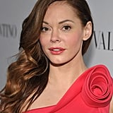 Rose McGowan donned a one-shoulder dress with a rose for Valentino's 50th anniversary party in LA.