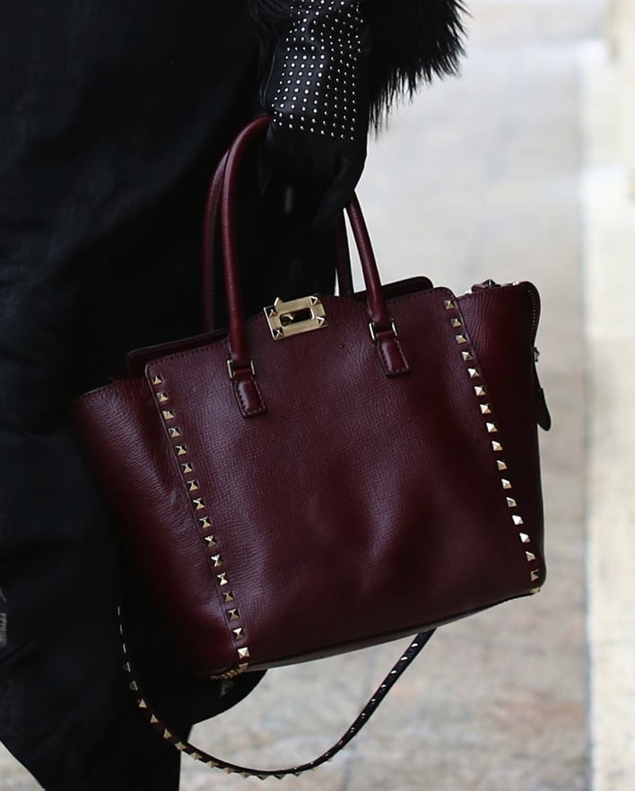 An aubergine Valentino tote gets tough with spiked studs.