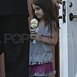 Suri Cruise on her way to mom Katie Holmes's photo shoot.