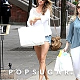 Gisele Bundchen carried two shopping bags.