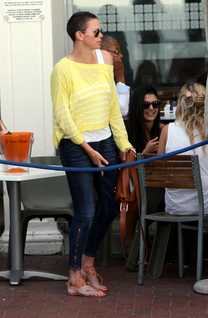Charlize Theron kept it casual in jeans and sandals.
