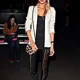 Poppy Delevigne attended the Matthew Williamson show wearing cool cutout leggings and red velvet flats.