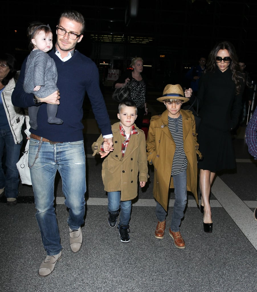 David and Victoria Beckham and their four kids departed out of LAX's international terminal Friday night on a flight headed to London. The family of six touched down in the UK yesterday with little Harper snuggled safely and warmly inside her baby carrier. The Beckhams are in England for their annual holiday trip to spend time with relatives and famous friends like Gordon Ramsay. Next year David and Victoria may not have to travel far if rumors of their move to Paris are true. David has yet to say if, and where, he'll be playing soccer in 2012, though many think it's a possibility Becks could sign with France's St. Germain club. No matter what his decision, it's bound to be a special holiday for David, Victoria, Cruz, Romeo, and Brooklyn as they prep for Harper's first Christmas. From career highs to the arrival of Harper, it's been a huge year for the family, so we took a look back at the Beckhams' cutest pictures of 2011 as part of our Best of 2011 coverage!